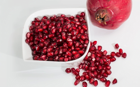 Pomegranate seeds in red bowl
