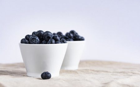 Blueberries in two white bowls
